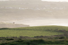 Coastal fields along the headlands at dusk Royalty Free Stock Photos