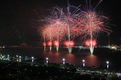 Coastal firework display. Firework display over the coast symbolizing New Year, celebration and pyrotechnics Stock Photo