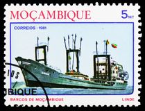 Coastal freightship Linde , Ships of Mozambique serie, circa 1981. MOSCOW, RUSSIA - OCTOBER 6, 2018: A stamp printed in Mozambique shows Coastal freightship royalty free stock images