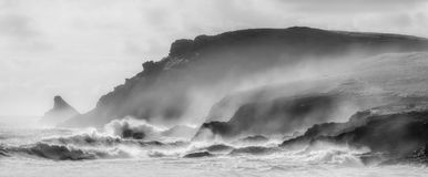Coastal Gales over Trevose Head, Cornwall. Atlantic gales batter the coastal location of Trevose Head in Cornwall. Image captured in black and white stock images