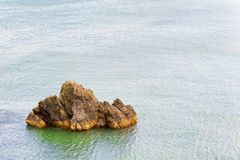 Coastal geological feature surrounded by water. Copyspace available in this coastal landscape image of geological featured rock island surrounded by the Pacific Royalty Free Stock Photography