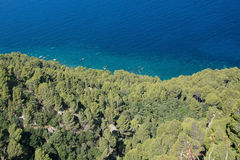Coastal green vegetation and turquoise Mediterranean water Stock Image