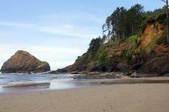 Coastal headlands and lighthouse Royalty Free Stock Image