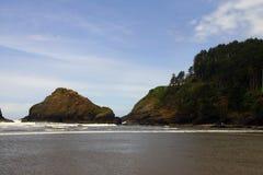 Coastal headlands and lighthouse Stock Photography