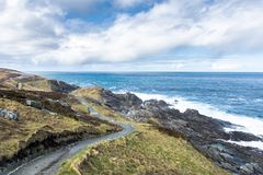 Coastal hiking path at Malin Head. This is a walking path that goes along the rocky shoreline at Malin Head Ireland Royalty Free Stock Image