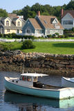 Coastal home and boat Royalty Free Stock Photo