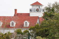 Coastal Home with Red Roof at Christmas stock image