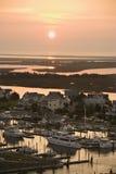 Coastal homes and marina. Aerial view of coastal village with marina on Bald Head Island, North Carolina royalty free stock photography