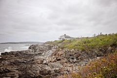 Coastal house on rocky cliff in Maine. Sea side House on rocky cliff overlooking Atlantic Ocean near Port;and Maine royalty free stock image