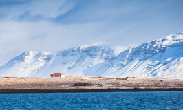 Coastal Icelandic landscape with snowy mountains Stock Photography