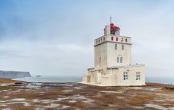 Coastal Icelandic lighthouse Dyrholaey. South coast of Iceland island stock images