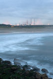 Coastal industry. To get late stormy near the sea with industry to the bottom Stock Photo