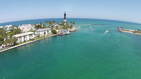 Coastal inlet in Florida aerial view. Coastal lighthouse and boating inlet aerial view in Florida stock video footage