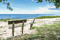 Coastal landscape at the Baltic Sea with settees on foreground Stock Photos