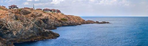 Coastal landscape banner, panorama - the rocky seashore with the village of Sozopolis. Near city of Sozopol in Bulgaria Royalty Free Stock Photography