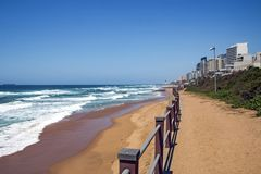 Coastal Landscape Beach and Sea at Umhlanga South Africa. Coastal landscape of green dune vegetation beach and sea against commercial and residential buildings Stock Photography
