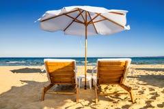 Coastal landscape - Beach umbrellas and loungers on the sandy seashore. The Kavatsi bay near city of Sozopol in Bulgaria royalty free stock photo