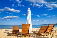 Coastal landscape - Beach umbrellas and loungers on the sandy seashore. The Kavatsi bay near city of Sozopol in Bulgaria stock photo