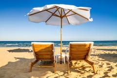Coastal landscape - Beach umbrellas and loungers on the sandy seashore. The Kavatsi bay near city of Sozopol in Bulgaria stock photos