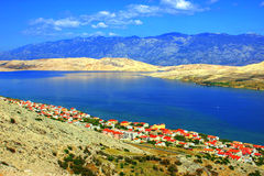Coastal Landscape with Blue Mountains. Coastal Landscape with Bay of Blue Adriatic Sea and Small Coastal Village and Blue Sky Above Stock Photos
