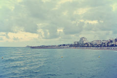 Coastal landscape on a cloudy windy afternoon; retro Instagram style Stock Image