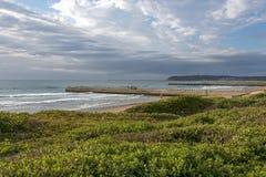 Coastal Landscape Dune Vegetation Beach Sea Against Cloudy Sky Stock Photos