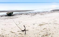 Coastal landscape with fishing boat Stock Photos
