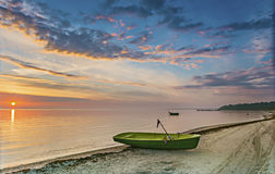 Coastal landscape with fishing boats at dawn Royalty Free Stock Images