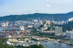 Coastal landscape of Hong Kong with its shipping industry. Aerial view of the coastal landscape in Hong Kong. The image shows the shipping industry spread along Royalty Free Stock Photos
