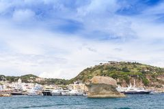 Coastal landscape of Ischia island, Italy. Lacco Ameno port with natural landmark Il Fungo, mushroom shaped rock Royalty Free Stock Photos