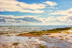 Coastal landscape at low tide in Scotland, UK. The town of Kirkc Stock Photography