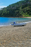 Coastal landscape with motor boat on sandy beach. Royalty Free Stock Images