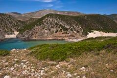 A coastal landscape with mountain, a beach, a wounderful sea. A coastal landscape with mountain, a beach, a blue sea royalty free stock photography