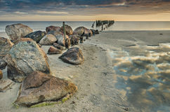 Coastal landscape with old broken fishery wharf, Baltic Sea Royalty Free Stock Images
