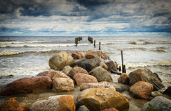 Coastal landscape with old broken pier, Baltic Sea, Europe Stock Images