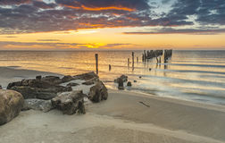 Coastal landscape with old broken pier, Baltic Sea Stock Photo