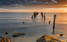 Coastal landscape with old broken pier, Baltic Sea Royalty Free Stock Photo