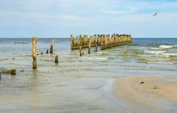 Coastal landscape with old broken pier, Baltic Sea Stock Images