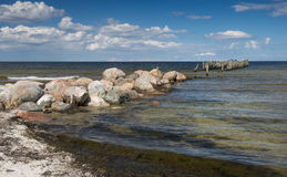 Coastal landscape with old broken pier Stock Photography