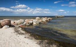 Coastal landscape with old broken pier Royalty Free Stock Image
