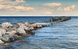 Coastal landscape with old broken pier Royalty Free Stock Photos