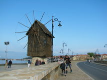 Coastal landscape with old windmill. Stock Image