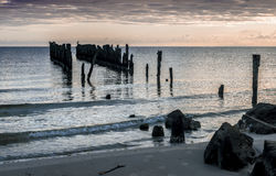 Coastal landscape with remains of old fisheries pier Stock Image