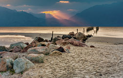 Coastal landscape with remains of old wooden pier Stock Images