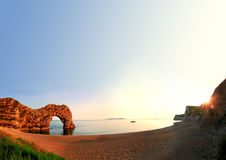 Coastal landscape with rocky arch and blue sky Stock Photography