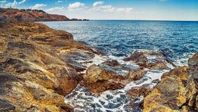 Coastal landscape - the rocky seashore with the village of Sozopolis Stock Photo
