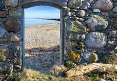 Coastal landscape seen through window of old building Royalty Free Stock Photos