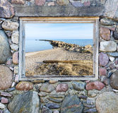 Coastal landscape seen through window of old building Royalty Free Stock Images