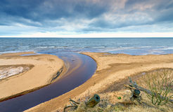Coastal landscape with a small river flowing into Baltic Sea Stock Photography