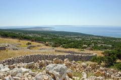 Coastal Landscape with Stone Walls. Coastal Landscape in Croatia with Long Stone Wall Stock Images